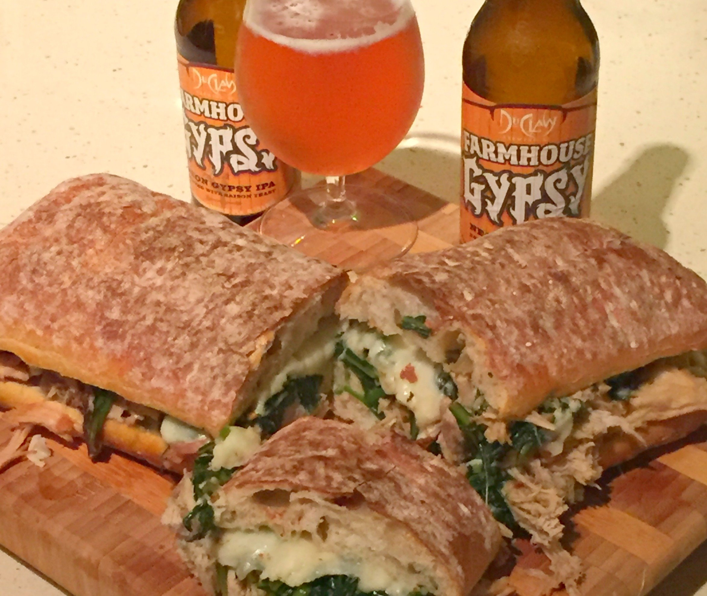 DuClaw Farmhouse Gypsy beer and sandwich