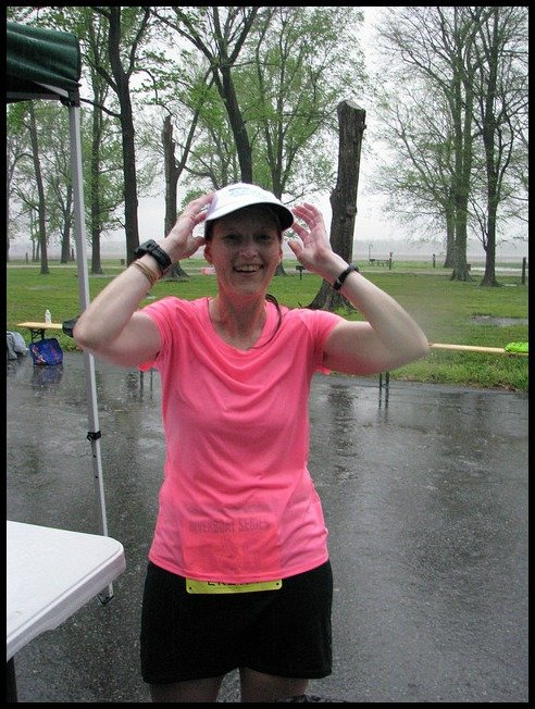 Running in the rain with a hat